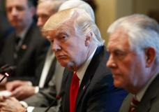 President Donald Trump listens as Iraqi Prime Minister Haider al-Abadi speaks during a meeting in the Cabinet Room of the White House in Washington, Monday, March 20, 2017. Secretary of State Rex Tillerson is at right. (AP Photo/Evan Vucci)