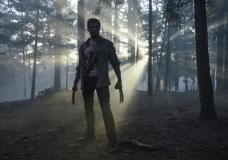 "This image released by Twentieth Century Fox shows Hugh Jackman from the film, ""Logan."" (Ben Rothstein/Twentieth Century Fox via AP)"