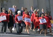 House Minority Leader Nancy Pelosi of Calif. center, and other Democratic Congressional members, walk down the steps on Capitol Hill in Washington, Wednesday, March 8, 2017, for an event to honor International Women's Day. (AP Photo/Susan Walsh)