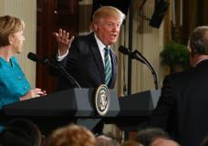 President Donald Trump, joined by German Chancellor Angela Merkel, left, speaks during a joint news conference in the East Room of the White House in Washington, Friday, March 17, 2017. (AP Photo/Andrew Harnik)