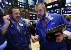 Specialist Charles Boeddinghaus, left, and trader Kevin Lodewick work on the floor of the New York Stock Exchange, Friday, March 10, 2017. Stocks are moving higher in early trading on Wall Street after the government reported solid job gains in the U.S. a month earlier. (AP Photo/Richard Drew)
