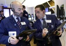 Traders Fred Demarco, left, and Tommy Kalikas work on the floor of the New York Stock Exchange, Monday, March 27, 2017. Banks and industrial companies are leading stocks lower on Wall Street in early trading. (AP Photo/Richard Drew)