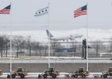 An United Airlines plane departs during the snowstorm at O'Hare International Airport in Chicago, Illinois, U.S., March 13, 2017. Some areas received up to 5 inches of snow, and more than 400 flights were cancelled at O'Hare. REUTERS/Kamil Krzaczynski
