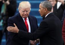 FILE PHOTO - President Barack Obama (R) greets President elect Donald Trump at inauguration ceremonies swearing in Donald Trump as the 45th president of the United States on the West front of the U.S. Capitol in Washington, U.S., January 20, 2017. REUTERS/Carlos Barria/File Photo