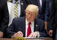 President Donald Trump signs the Education Federalism Executive Order during a federalism event with governors in the Roosevelt Room of the White House in Washington, Wednesday, April 26, 2017. (AP Photo/Andrew Harnik)