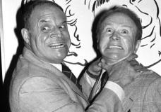 FILE - In this Nov. 10, 1977 file photo, comedian Don Rickles, left, pretends to strangle fellow comedian Red Buttons prior to an Annual Stag Roast in Los Angeles. Rickles died Thursday, April 6, 2017, of kidney failure at his Los Angeles home. He was 90. (AP Photo/ Lennox McLendon, File)