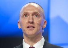 FILE - In this Dec. 12, 2016, file photo, Carter Page, a former foreign policy adviser of U.S. President-elect Donald Trump, speaks at a news conference at RIA Novosti news agency in Moscow, Russia. A published report says the FBI obtained a court order to monitor communications of an adviser to then-candidate Donald Trump last summer. The Washington Post reported April 11, 2017 the application to a special court to monitor Carter Page was part of the investigation into potential links between the Republican's presidential campaign and Russia. The newspaper said its report was based on unnamed law enforcement and other U.S. officials. (AP Photo/Pavel Golovkin, file)