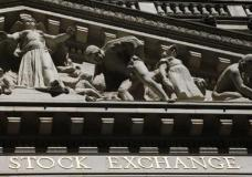 """FILE - This July 15, 2013, file photo, shows the New York Stock Exchange. Global stock markets turned lower and the dollar was volatile Thursday, April 13, 2017, after President Donald Trump withdrew a threat to declare China a currency manipulator and said the U.S. currency was """"getting too strong."""" Tensions over North Korea also weighed on investors ahead of a long weekend in many markets. (AP Photo/Mark Lennihan, File)"""