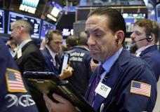 Trader Tommy Kalikas works on the floor of the New York Stock Exchange, Thursday, May 4, 2017. U.S. stocks are mostly lower Thursday morning as oil prices continue to drop and energy companies take sharp losses. (AP Photo/Richard Drew)
