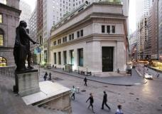 FILE - In this Oct. 8, 2014, file photo, people walk to work on Wall Street beneath a statue of George Washington, in New York. Stocks are opening slightly higher on Wall Street, Thursday, May 4, 2017, led by gains in banks and makers of consumer goods. (AP Photo/Mark Lennihan, File)