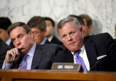 Sen. Richard Burr, R-N.C., right, chairman of the Senate Select Committee on Intelligence, and Vice Chairman Mark Warner, D-Va., left, listen as Attorney General Jeff Sessions testifies before the Senate Select Committee on Intelligence about his role in the firing of FBI Director James Comey and the investigation into contacts between Trump campaign associates and Russia, on Capitol Hill in Washington, Tuesday, June 13, 2017. (AP Photo/J. Scott Applewhite)