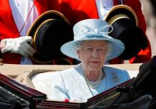 Britain's Queen Elizabeth II leaves Buckingham Palace in a carriage, to attend the annual Trooping the Colour Ceremony in London, Saturday, June 17, 2017. (AP Photo/Kirsty Wigglesworth)