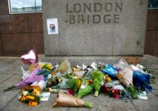 A floral tribute in the London Bridge area following Saturday's attack in London, Monday, June 5, 2017. Police arrested several people and are widening their investigation after a series of attacks described as terrorism killed several people and injured more than 40 others in the heart of London on Saturday. (AP Photo/Alastair Grant)
