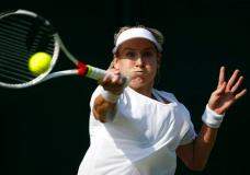 Bethanie Mattek-Sands of the United States returns the ball to Romania's Sorana Cirstea during their Women's Singles Match on day four at the Wimbledon Tennis Championships in London Thursday, July 6, 2017. (AP Photo/Alastair Grant)