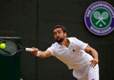 Croatia's Marin Cilic returns to Luxembourg's Gilles Muller during their Men's Singles Quarterfinal Match on day nine at the Wimbledon Tennis Championships in London Wednesday, July 12, 2017. (AP Photo/Alastair Grant)