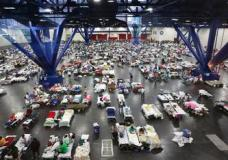 Evacuees escaping the floodwaters from Tropical Storm Harvey rest at the George R. Brown Convention Center that has been set up as a shelter in Houston, Texas, Tuesday, Aug. 29, 2017. (AP Photo/LM Otero)