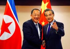 North Korean Foreign Minister Ri Yong Ho, left, is greeted by his Chinese counterpart Wang Yi prior to their bilateral meeting in the sidelines of the 50th ASEAN Foreign Ministers' Meeting and its Dialogue Partners Sunday, Aug. 6, 2017 in suburban Pasay city, south Manila, Philippines. Bolstered by new U.N. sanctions, the United States and North Korea's neighbors are joining in a fresh attempt to isolate Pyongyang over its nuclear and missile programs, in a global campaign cheered on by U.S. President Donald Trump. (AP Photo/Bullit Marquez)
