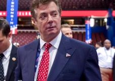 FILE - In this July 18, 2016 file photo, then-Trump campaign chairman Paul Manafort walks around the convention floor before the opening session of the Republican National Convention in Cleveland. A spokesman for President Donald Trump's former campaign chairman, Paul Manafort, says that FBI agents served a search warrant at one of his homes.  (AP Photo/Carolyn Kaster, File)