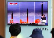 People watch a TV screen showing a local news program reporting about North Korea's missile launch at Seoul Train Station in Seoul, South Korea, Wednesday, Aug. 30, 2017. North Korean leader Kim Jong Un called for more weapons launches targeting the Pacific Ocean to advance his country's ability to contain Guam, state media said Wednesday, a day after Pyongyang for the first time flew a ballistic missile designed to carry a nuclear payload over Japan. (AP Photo/Lee Jin-man)