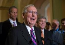 """FILE - In this Aug. 1, 2017 file photo, Senate Majority Leader Mitch McConnell of Ky. speaks on Capitol Hill Washington. McConnell is condemning the """"messages of hate and bigotry"""" carried by the KKK and white supremacist groups. (AP Photo/J. Scott Applewhite, File)"""