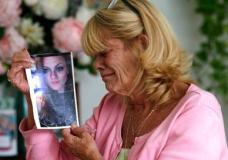 """In this Thursday, July 13, 2017 photo, Michelle Holley holds a photograph of her daughter Jaime Holley, 19, who died of a heroin overdose in November 2016, at her home in Fort Lauderdale, Fla. The Reflections treatment center looked like just the place for her youngest daughter to kick heroin. """"It looked fine. They were saying all the right things to me. I could not help my child so I trusted them to help my child,"""" Holley said. Instead, the center refused to give 19-year-old Jaime Holley her prescription medicine when she left, forcing her to use illegal drugs to avoid acute withdrawal symptoms, her mother said. (AP Photo/Lynne Sladky)"""