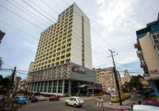 """The Hotel Capri in Havana, Cuba, is photographed Tuesday, Sept. 12, 2017. New details about a string of mysterious """"health attacks"""" on U.S. diplomats in Cuba indicate the incidents were narrowly confined within specific rooms or parts of rooms. Aside from their homes, officials said Americans were attacked in at least one hotel, the recently renovated Hotel Capri, steps from the Malecon, Havana's iconic, waterside promenade.(AP Photo/Desmond Boylan)"""