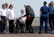 President Donald Trump shakes hands with Texas Gov. Greg Abbott as he and first lady Melania Trump, right, arrive via Air Force One at Ellington Field in Houston, Saturday, Sept. 2, 2017. The president and first lady Melania Trump arrived Saturday morning in Houston, and their first order of business is to meet with people impacted by the storm and flooding. They're also set to stop by a relief center to speak with volunteers and then head to Lake Charles, Louisiana, another area devastated by Harvey.   (AP Photo/Susan Walsh)