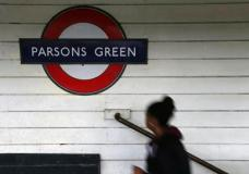 A passenger walks onto the platform at Parsons Green subway station after it was reopened following a terrorist attack on a train at the station yesterday in London, Saturday, Sept. 16, 2017. British authorities are searching for suspects in the London subway blast that injured more than two dozen people as hundreds of soldiers are being deployed across the country. (AP Photo/Tim Ireland)