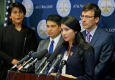Faride Cuevas, second from right, a participant in the Deferred Action for Childhood Arrivals, or DACA, program, talks to reporters, Wednesday, Sept. 6, 2017, in Seattle, as Washington Attorney Genera Bob Fergus, right, and two other DACA participants look on. More than a dozen states and the District of Columbia filed a lawsuit Wednesday to block President Donald Trump's plan to end a program protecting young immigrants from deportation, after U.S. Attorney General Jeff Sessions said Tuesday that DACA will end in six months to give Congress time to find a legislative solution for the immigrants. (AP Photo/Ted S. Warren)