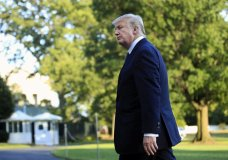 President Donald Trump walks towards the White House in Washington, Sunday, Sept. 24, 2017, after speaking to reporters upon his return. Citizens of eight countries will face new restrictions on entry to the U.S. under a proclamation signed by Trump on Sunday. (AP Photo/Manuel Balce Ceneta)