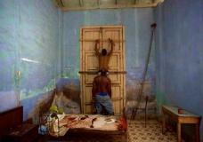 Men board up a door in preparation for Hurricane Irma in Caibarien, Cuba, Friday, Sept. 8, 2017. Cuba evacuated tourists from beachside resorts after Hurricane Irma left thousands homeless on a devastated string of Caribbean islands and spun toward Florida for what could be a catastrophic blow this weekend. (AP Photo/Desmond Boylan)