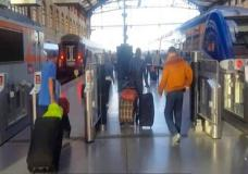 This image taken from video shows passengers inside Marseille-Saint-Charles railway station in Marseille, France on Sunday Sept. 17, 2017. Four young US tourists were attacked with acid Sunday at a train station in the French city of Marseille. (AP Photo)