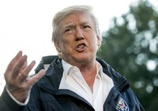 President Donald Trump talks to reporters as he walks to board Marine One on the South Lawn of the White House in Washington, Tuesday, Oct. 3, 2017, for a short trip to Andrews Air Force Base, Md. and then on to Puerto Rico. (AP Photo/Andrew Harnik)