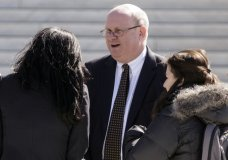 FILE - In this March 21, 2016, file photo, attorney Marc Elias, one of several lawyers who appeared in the in the case of Wittman v. Personhuballah, stands on the plaza of the Supreme Court in Washington. Hillary Clinton's presidential campaign and the Democratic National Committee helped fund a political research firm that produced a dossier of allegations about President Donald Trump's ties to Russia. That's according to a person familiar with the situation who spoke on Oct. 24, 2017, to The Associated Press. The person says the arrangement, first reported by The Washington Post, was coordinated by a lawyer for the campaign and the DNC and his law firm. That lawyer, Marc Elias, did not immediately return an email seeking comment. (AP Photo/J. Scott Applewhite)