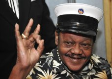 FILE - In this Nov. 5, 2008 file photo, Fats Domino waves to fans before a ceremony re-presenting two Grammy awards to replace the ones that he lost from Hurricane Katrina's flooding in New Orleans. Domino, the amiable rock 'n' roll pioneer whose steady, pounding piano and easy baritone helped change popular music even as it honored the grand, good-humored tradition of the Crescent City, has died. He was 89. Mark Bone, chief investigator with the Jefferson Parish, Louisiana, coroner's office, said Domino died Tuesday, Oct. 24, 2017. (AP Photo/Cheryl Gerber)