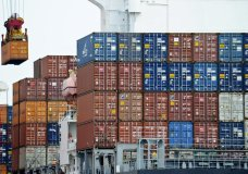 """FILE - In this Aug. 5, 2010, file photo, a container is loaded onto a cargo ship at the Tianjin port in China. The United States is joining a fight against China at the World Trade Organization in a decision likely to ratchet up tensions between Washington and Beijing. The U.S. is supporting the European Union in a dispute over China's status at the WTO. The United States and EU contend that the Chinese government continues to interfere so heavily in the country's commerce that China remains a """"non-market'' economy. (AP Photo/Andy Wong, File)"""