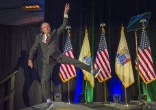 New Jersey Gov.-elect Phil Murphy leaps as he jumps onto the stage at his victory party Tuesday, Nov. 7, 2017, in Asbury Park, N.J. (Tom Gralish/The Philadelphia Inquirer via AP)