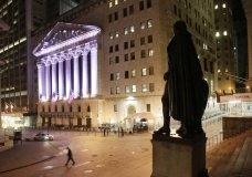 FILE - In this Wednesday, Oct. 8, 2014, file photo, a statue of George Washington stands near the New York Stock Exchange, in background. Stocks are opening broadly higher on Wall Street, Tuesday, Nov. 28, 2017, and several companies are moving on deal news. (AP Photo/Mark Lennihan, File)