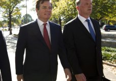 Paul Manafort accompanied by his lawyer Kevin Downing, right, arrives at U.S. Federal Court, in Washington, Thursday, Nov. 2, 2017. Manafort, President Donald Trump's former campaign chairman, and Manafort's business associate Rick Gates have pleaded not guilty to felony charges of conspiracy against the United States and other counts. ( AP Photo/Jose Luis Magana)