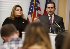 Resident Commissioner Jenniffer Gonzalez-Colon, who represents Puerto Rico as a nonvoting member of Congress, listens as Puerto Rico Gov. Ricardo Rossello speaks during a news conference to urge Congress to include Puerto Rico in the Supplemental Disaster Relief Package, Monday, Nov. 13, 2017, in Washington. (AP Photo/Evan Vucci)