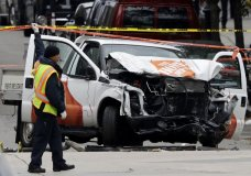 A damaged Home Depot truck remains on the scene Wednesday, Nov. 1, 2017, after the driver mowed down people on a riverfront bike path near the World Trade Center on Tuesday in New York. (AP Photo/Mark Lennihan)