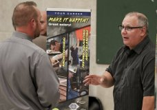 In this Thursday, Nov. 2, 2017, photo, a job recruiter looking for sheet metal workers, right, speaks with an attendee at a job fair in Cheswick, Pa. On Thursday, Nov. 16, 2017, the Labor Department reports on the number of people who applied for unemployment benefits a week earlier. (AP Photo/Keith Srakocic)