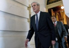 FILE - In this June 21, 2017, file photo, former FBI Director Robert Mueller, the special counsel probing Russian interference in the 2016 election, departs Capitol Hill in Washington. President Donald Trump's transition organization is arguing that a government agency improperly turned over a cache of emails to Mueller as part of his investigation into contacts between Trump associates and Russia. The complaint by the transition team is the latest attempt to undermine Mueller's investigation in the public sphere. (AP Photo/Andrew Harnik, File)