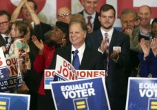 FILE - In this Tuesday, Dec. 12, 2017 file photo, Democrat Doug Jones speaks in Birmingham, Ala. Roy Moore is going to court to try to stop Alabama from certifying Jones as the winner of the U.S. Senate race. Moore filed a lawsuit Wednesday evening, Dec. 27, 2017, in Montgomery Circuit Court. (AP Photo/John Bazemore, File)