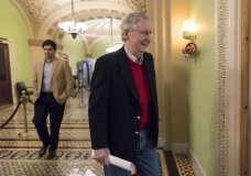 Ready to leave for the Christmas recess, Senate Majority Leader Mitch McConnell, R-Ky., walks to a news conference to discuss the GOP agenda for next year and and his accomplishments in the first year of the Trump Administration, on Capitol Hill in Washington, Friday, Dec. 22, 2017. Their tax bill triumph in the rear-view mirror, Republicans running Congress face a 2018 in which they'll need Democratic votes to get almost anything done. (AP Photo/J. Scott Applewhite)