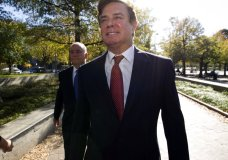 """FILE - In this Nov. 2, 2017, file photo, Paul Manafort accompanied by his lawyers, arrives at U.S. Federal Court, in Washington. Prosecutors working for special counsel Robert Mueller say Manafort has been working on an op-ed with a longtime colleague """"assessed to have ties"""" to a Russian intelligence service. Court papers say that Manafort and the colleague sought to publish the op-ed under someone else's name and intended it to influence public opinion about his work in Ukraine. ( AP Photo/Jose Luis Magana, File)"""