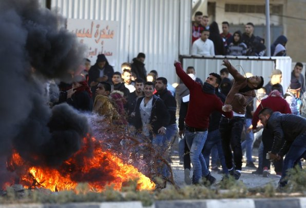Palestinians clash with Israeli troops following a protest against U.S. President Donald Trump's decision to recognize Jerusalem as the capital of Israel in the West Bank City of Nablus, Friday, Dec. 8, 2017. (AP Photo/Majdi Mohammed)
