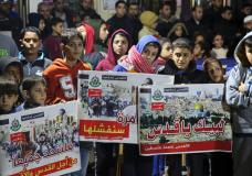 """Youths hold pictures during a protest organized by Hamas against the likely U.S. decision to recognize Jerusalem as Israel's capital, in Jebaliya refugee camp, Gaza Strip, Wednesday, Dec. 6, 2017. Arabic reads, """"Here we are, Jerusalem,"""" and """"we will unite for you, Jerusalem."""" President Donald Trump is forging ahead with plans to recognize Jerusalem as Israel's capital despite intense Arab, Muslim and European opposition to a move that would upend decades of U.S. policy and risk potentially violent protests. (AP Photo/Adel Hana)"""