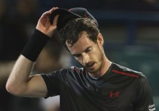 FILE - In this Friday, Dec. 29, 2017 file photo, Great Britain's Andy Murray reacts after he lost a match to Spain's Roberto Bautista Agut during the second day of the Mubadala World Tennis Championship in Abu Dhabi, United Arab Emirates. Andy Murray says he has undergone surgery on his right hip and hopes to be back playing later this year, it was announced Monday, Jan. 8, 2018. The former No. 1-ranked Murray, a three-time major winner, has not played a competitive match since a quarterfinal exit at Wimbledon last July. (AP Photo/Kamran Jebreili, File)