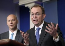 Director of the Office of Management and Budget Mick Mulvaney, right, and Marc Short, left, White House director for legislative affairs, speak to members of the media in the Brady Press Briefing Room of the White House, Friday, Jan. 19, 2018, about a potential government shutdown this weekend. (AP Photo/Pablo Martinez Monsivais)